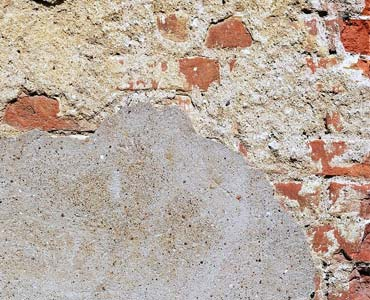Weathered plaster from brickwork