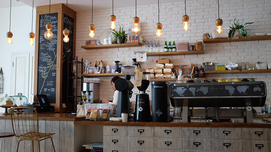 Coffee bar counter with painted brick wall